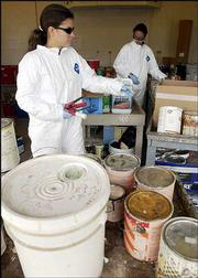 Kathy Richardson, left, and Michelle Crank, both hazardous waste materials technicians with the Lawrence-Douglas County Waste Reduction and Recycling Division, unload a delivery of house paint at the Household Hazardous Waste Collection Facility. Douglas County residents are encouraged to drop off household hazardous wastes at the facility to keep them out of the regular trash.
