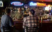 Johnny's Tavern is celebrating 50 years in business with a month of special offers and gatherings. Bartender Will Lenz visited with bar patrons Friday at the North Lawrence eating-and-drinking establishment.