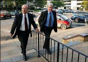 Defense Attorney Mike Francis, left, and his client, Topeka Mayor Butch Felker, make their way into the Shawnee County Courthouse in Topeka, for the mayor's suspension hearing. Dist. Atty. Robert Hecht is seeking to temporarily remove Felker from office pending a trial on ethics violations.