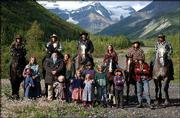 The 17 members of the Pilgrim family stand on their land near the head of McCarthy Creek, 14 miles from the town of McCarthy, Alaska. Volunteer bush pilots are flying winter supplies to the family whose cabin in the backcountry of Wrangell-Saint Elias National Park and Preserve has been isolated by a dispute over use of an old road through the park. Papa Pilgrim, whose given name is Bobby Hale, is feuding with the National Park Service over the right to use a 14-mile mining road. The Park Service closed the road to motorized vehicles and has denied Pilgrim a permit.