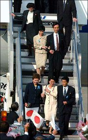 Five Japanese kidnapped by North Korean agents nearly a quarter-century ago arrive Oct. 15, 2002, at Haneda International Airport in Tokyo for their first homecoming from the communist country.
