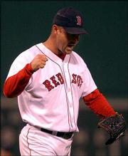 Boston's Tim Wakefield pumps his fist after getting the third out in the sixth inning of a 3-2 victory over the Yankees. The outcome Monday in Boston evened the American League championship series at 2.