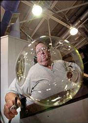 Dave Robenolt works on a glass bowl at the Steuben Glass factory inside the Corning Museum of Glass in Corning, N.Y. Steuben is the only luxury lead crystal still handcrafted in the United States. The firm has been in business for 100 years.