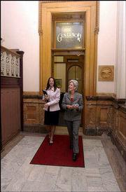 Staff member Jennifer Crow and Gov. Kathleen Sebelius leave the governor's office on the way to a scheduled event.
