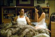 "Jay Harrington, left, and Rena Sofer appear in a scene from NBC's ""Coupling."" The racy new sitcom airs at 8:30 p.m. Thursdays on NBC, Sunflower Broadband Channels 8 and 14."
