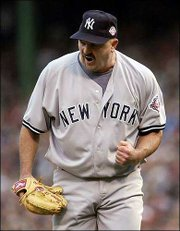 New York yankees pitcher David Wells is pumped up after striking out Boston's Nomar Garciaparra to end the third inning. The Yankees beat the Red Sox, 4-2, Tuesday in Boston, taking a 3-2 lead in the AL championship series.