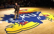 Kansas University men's basketball coach Bill Self greets KU fans during during his first Late Night in the Phog Friday at Allen Fieldhouse in 2003.