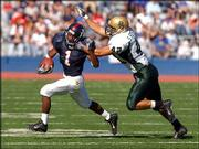 Kansas&#39; John Randle, left, sprints away from Baylor&#39;s Stephen