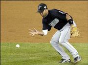 Marlins shortstop Alex Gonzalez barehands an infield roller hit by New York's Jason Giambi in the sixth inning. Florida won Saturday's World Series opener, 3-2, in New York.