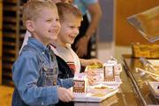 Lunch buddies A.J. Zarnowiec, 6, left, and Sam Oliver, 6, smile through the lunch line at Quail Run School.
