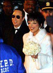 David Gest and Liza Minnelli leave Marble Collegiate Church in New York after their wedding in this file photo from March 16, 2002. Gest sued Minnelli for $10 million Tuesday, accusing his estranged wife of alcohol-fueled violence that caused neurological damage and headaches.