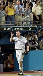 New York pitcher Roger Clemens tips his cap at the end of the seventh inning. He likely made his final career major-league appearance Wednesday in Miami.