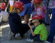 Nathan Burgoon, 5, right, looks at a container of used oil as his sister Ashley, 9, left, looks on. Safety and science were among the topics covered Wednesday as a class of Marion Springs Elementary students toured a rock quarry near Overbrook.