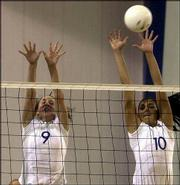 Kansas University sophomores Andi Rozum, left, and Josi Lima reach for a block against Texas. The Jayhawks beat the Longhorns, 3-2, Wednesday at Horejsi Center.
