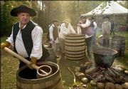 David Pickerell, master distiller for Maker's Mark, carries water to be boiled as he and other master distillers gather on the archaeology site of George Washington's distillery. The distillers worked in Mount Vernon, Va., Tuesday in efforts to recreate the founding father's popular whiskey recipe.