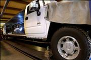 A welder attaches side panels on a stretched Hummer H2 at S and R Coach in Strafford, Mo. The Hummer has become the latest craze in limousines.