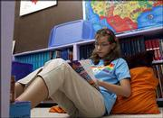 Fifth-grader Kelsey Reynolds studies in her preferred learning style area in her classroom at Delia Charter School, northwest of Topeka. Reynolds' student inventory test suggested that she studied better away from her desk in a more cozy environment.