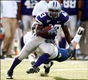 Kansas State running back Darren Sproles outruns a KU defender for