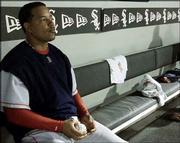 Boston's Manny Ramirez sits in the dugout during a game last season at Chicago's U.S. Cellular Field. The left fielder has been placed on waivers by the Red Sox.