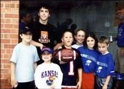 The Carmody cousins show their Jayhawk spirit at the first Kansas University football game of the 2003 season on Aug. 30. Tyler Carmody, 17, stands in back. The others, from left, are Jeff Carmody, 12; Ellie Carmody, 6; Brian Carmody, 10; Margie Carmody, 12; Nikki Carmody, 8; and Matt Carmody, 7. Tyler and Jeff are the sons of Tom and Kay Carmody; Nikki and Matt are the children of John and Wendy Carmody, all of Lawrence; and Ellie, Brian and Margie are the children of Mike and Dee Dee Carmody, Omaha, Neb. Grandparents Tom and Grace Carmody, Lawrence, submitted the picture.