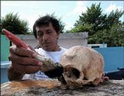 Mayan Carlos Cahuich cleans the skull of his father at a cemetery in a 500-year-old ritual in preparation for Day of the Dead celebrations in Pomuch, in the state of Campeche. Mexico's Day of the Dead on Nov. 2 mixes Indian traditions and the Roman Catholic Church's All Souls' Day.