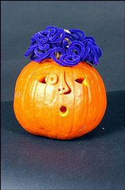 "Curley Top by Lana Grove won ""Best Original Design"" in the Great Pumpkin Carving Contest."