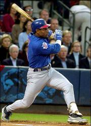 Chicago's Sammy Sosa bats during the National League divisional playoffs. Sosa said Friday he was turning down a chance to become a free agent to remain with the Cubs two more seasons.