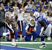 Houston running back Domanick Davis crosses the goal line for a 15-yard touchdown run against Indianapolis. Davis, who scored against the Colts Sunday in Indianapolis, has emerged his rookie season as the Texans' top running back.
