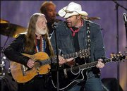 "Willie Nelson, left, joins Toby Keith as they sing ""Beer for My Horses"" during the 38th annual Academy of Country Music Awards on May 21 in Las Vegas. The nominees for the Country Music Assn. Awards -- to be held Wednesday -- reflect a shift from pop-leaning crossover females to the more male-dominated traditional country. Keith leads all performers with seven nominations, and country legend Nelson has several nominations."