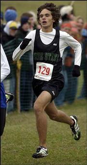 Free State High's Danny Schneider runs down the home stretch. Schneider placed 11th, helping the Firebird boys to a sixth-place finish Saturday at Rim Rock Farm.