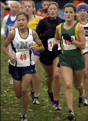 Blue Valley North's Jana Gwinn, left, Shawnee Mission South's Connie Abbott, center, and Free State's Alysha Valencia set the pace in the girls Class 6A state cross country race. Gwinn won, and Valencia placed sixth in the event Saturday at Rim Rock Farm.