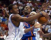 Orlando guard Tracy McGrady, left, and New York forward Shandon Anderson battle for a loose ball. The Knicks won Monday at Orlando, Fla.