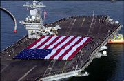 The aircraft carrier USS Nimitz returns to its home port at Naval Air Station North Island in Coronado, Calif. The USS Nimitz returned home Wednesday to San Diego Bay, winding up a mission that stretched more than eight months and made it the last carrier to leave Iraq.