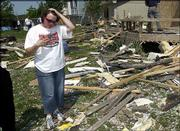 Riat's home was showered with debris from the Aberdeen South apartments on West 27th Street, the first buildings hit by the twister.