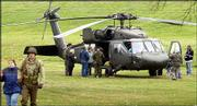 A UH-60 Black Hawk helicopter attracts visitors to Ottawa's Forest Park during Veterans Day Weekend remembrance events. Saturday's events included a parade, re-enactors and a USO-style show. The event continues today.
