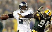 Donovan McNabb throws a pass while being rushed by Green Bay's Kabeer Gbaja-Biamila. For the fourth week in a row, the Eagles rallied in the fourth quarter to win. Philly defeated the Packers, 17-14, Monday night in Green Bay, Wis.