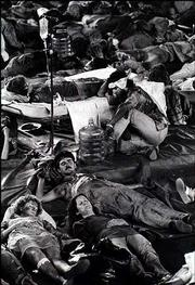 Actors portraying victims of a nuclear explosion near Lawrence are spread out across the floor of Allen Fieldhouse.