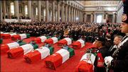 A capacity crowd packs St. Paul's Basilica in Rome for services for 19 Italians killed in Iraq. The state funeral service was Tuesday.