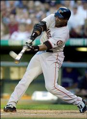 San Francisco left fielder Barry Bonds won his record sixth National League MVP award Tuesday, becoming the first player to earn the honor in three consecutive years.