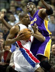 Detroit's Corliss Williamson, left, drives on Los Angeles' Horace Grant. Williamson scored 14 points and was one of six Pistons to post double figures in a 106-96 victory Tuesday night in Auburn Hills, Mich.