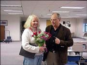 Pat Grzenda, left, who teaches adaptive physical education to children with disabilities, is congratulated by Lawrence Supt. Randy Weseman. Friday, Grzenda was named the 2003-2004 Lawrence master teacher.
