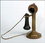 "This phone, marked ""Roycroft,"" is made of hammered copper and Baklite. It was used by American Bell Telephone Co. clients about 1910. The phone sold at an auction for $8,000."
