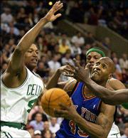 New York's Shandon Anderson (49) goes to the hoop against Boston's Tony Battie, left, and Paul Pierce. Anderson scored a season-high 28 points in the Knicks' 94-88 victory Monday night in Boston.