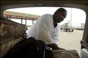 On his way to Amarillo, Texas, for Thanksgiving, Mario Echols reorganizes his family's luggage at the Kansas Turnpike service area east of Lawrence. Echols, from Omaha, Neb., hit the road on Wednesday for the Thanksgiving holiday, which he celebrates annually with family in Texas. According to AAA, 36 million people nationwide were expected to travel 50 miles or more from their home this holiday weekend.