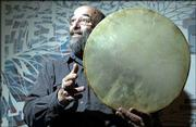 Charles Gruber displays a tar, a Middle Eastern drum used in Sufi dancing and worship. Gruber became an ordained Sufi minister in 1976.