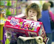 "Kim Midgett of New Egypt, N.J., looks at the popular toy My Little Pony Celebration Castle at the Toys ""R"" Us store in Lawrenceville, N.J. She was holiday shopping on Nov. 21."