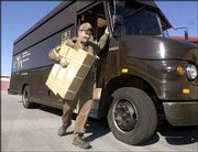 UPS driver Jeff Spangler delivers a package in Roswell, Ga.