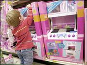 "Max Donaldson, 3, of Hopewell, N.J., plays with a Barbie Smart Kitchen at the Toys ""R"" Us store in Lawrenceville, N.J. Retail giants Wal-Mart Stores Inc. and Toys ""R"" Us Inc. engaged in a battle in which the winner will reap the rewards of being the nation's largest toy retailer."