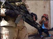 An Iraqi girl covers her face as U.S. Army soldiers search for insurgents Saturday in the center of Baghdad.