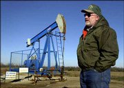Dwayne Umbarger talks about the increased production of methane gas in southeast Kansas as he stands in front of one of two wells on his farm near Thayer. Production of the gas has increased sharply in what may be one of the nation's largest reserves of coal-bead methane.
